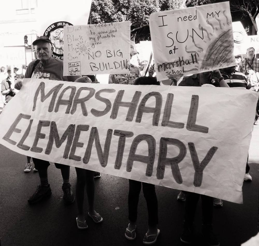 Marshall elementary students and parents say no to Monster Shadows on playgrounds. Photo by Lola Casanova.